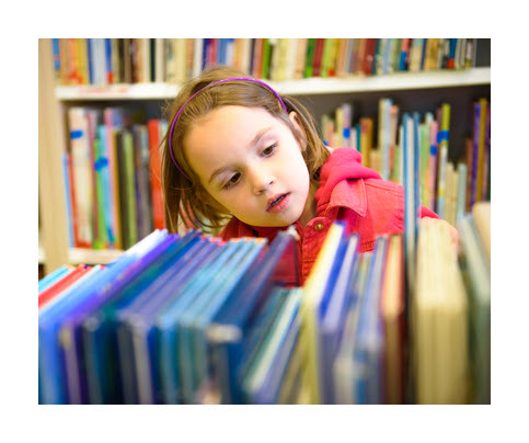 Image of girl browsing library bookshelf