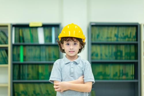Image of child with hard hat on ready to go to work